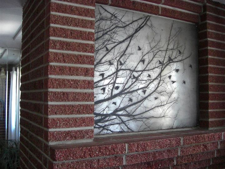 Acid etched art on steel panel of tree branches by artist Garrett Price