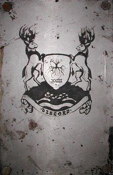 Acid etched art on steel panel of a discordian family crest drawing by artist Garrett Price