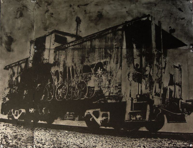 Acid etched art on steel panel of a graffiti covered train caboose in Portland, Oregon by artist Garrett Price